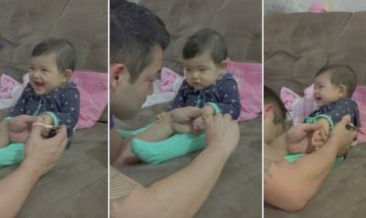 爪を切ろうとするとウソ泣きで父親を困らせる赤ちゃん